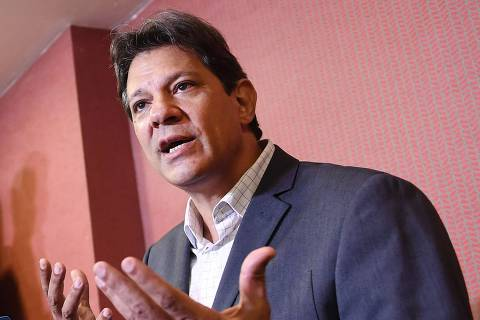 Brazil's presidential candidate for the Workers' Party (PT), Fernando Haddad, speaks during a press conference after a meeting at the Brazilian National Conference of Bishops, in Brasilia on October 11, 2018. (Photo by EVARISTO SA / AFP) ORG XMIT: ESA1010
