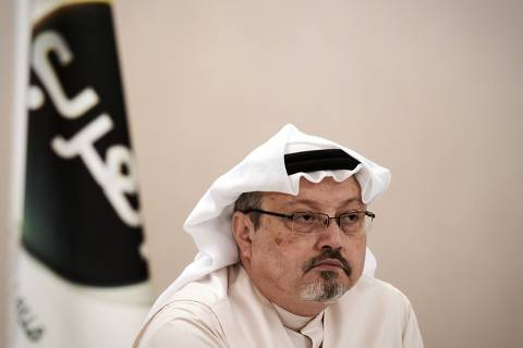 TOPSHOT - (FILES) In this file photo taken on December 15, 2014, general manager of Alarab TV, Jamal Khashoggi, looks on during a press conference in the Bahraini capital Manama. - Turkish police believe that prominent Saudi journalist and critic Jamal Khashoggi was murdered inside the Saudi mission in Istanbul after he went missing on October 2, 2018, according to an unnamed government official. (Photo by MOHAMMED AL-SHAIKH / AFP) ORG XMIT: MAS02