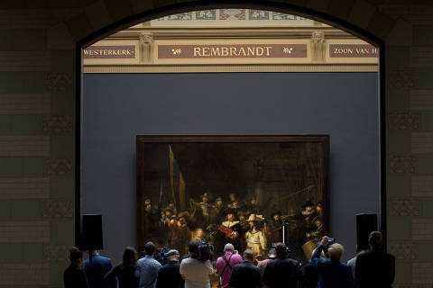 Journalists attend a press conference where the announcement was made that Rembrandt's Night Watch, rear, will be restored next year in the public eye at the Rijksmuseum in Amsterdam, Netherlands, Tuesday, Oct. 16, 2018. (AP Photo/Peter Dejong) ORG XMIT: PDJ105