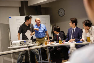 Pete Pranica, the announcer for the Memphis Grizzlies, teaches a workshop for Japanese announcers on how to commentate an NBA game, in Tokyo.