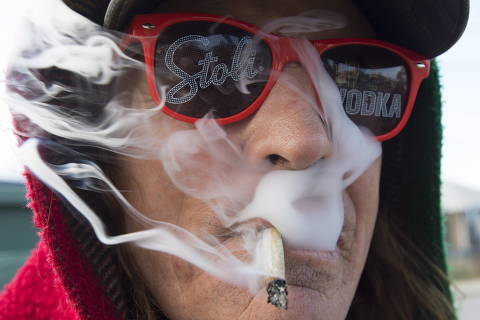 Bill Semeniuk, 67, smokes cannabis in Kamloops, British Columbia, Wednesday, Oct. 17, 2018. Canada became the largest country with a legal national marijuana marketplace as sales began early Wednesday. (Jonathan Hayward/The Canadian Press via AP) ORG XMIT: JOHV130