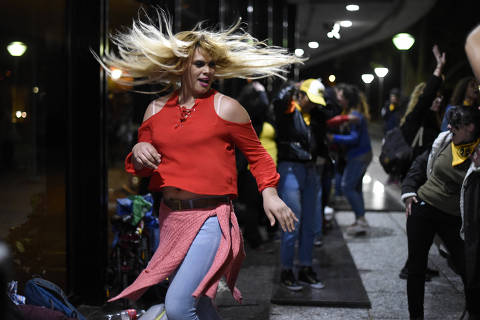 Activists dance to celebrate outside the Legislative Palace the approval of the Integral law for Trans People that was voted by Uruguayan legislators in Montevideo, Uruguay, Friday, Oct. 19, 2018. (AP Photo/Matilde Campodonico) ORG XMIT: MVD104