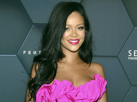 FILE - In this Friday, Sept. 14, 2018 file photo, singer Rihanna arrives at the Fenty Beauty by Rihanna one year anniversary party at Sephora in New York. Los Angeles police have arrested four people they say targeted celebrity homes for burglary, including those of Rihanna, Christina Milian, Dodgers star Yasiel Puig and Rams wide receiver Robert Woods. At a news conference in Los Angeles Tuesday, Oct. 2, police displayed recovered items they believe were stolen, including expensive watches, handbags, jewelry and cellphones. (Photo by Evan Agostini/Invision/AP, File) ORG XMIT: LA206