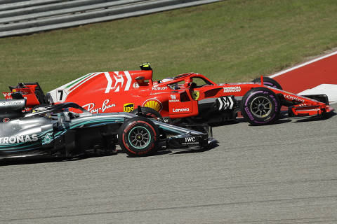Ferrari driver Kimi Raikkonen, of Finland, passes Mercedes driver Lewis Hamilton, of Britain, during the Formula One U.S. Grand Prix auto race at the Circuit of the Americas, Sunday, Oct. 21, 2018, in Austin, Texas. (AP Photo/Eric Gay) ORG XMIT: TXDC115