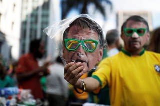 A street vendor sells a mask of Jair Bolsonaro, far-right lawmaker and presidential candidate of the Social Liberal Party (PSL), in a demonstration in Sao Paulo