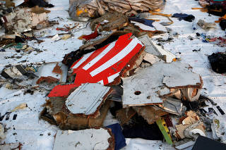 Wreckage recovered from Lion Air flight JT610, that crashed into the sea, lies at Tanjung Priok port in Jakarta