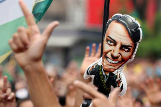 FILE PHOTO: Supporters of presidential candidate Bolsonaro attend a demonstration in Sao Paulo