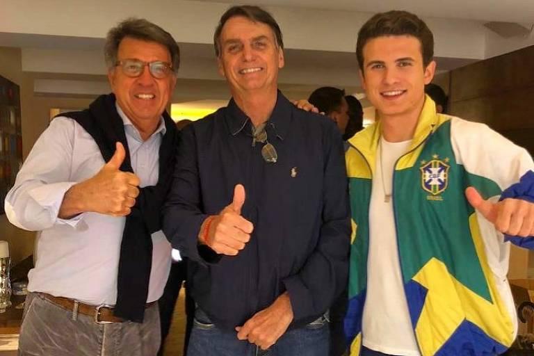 André ao lado do pai e de Jair Bolsonaro