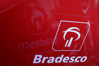 FILE PHOTO: The logo of Brazil's Banco Bradesco is seen at a rental bike service in Sao Paulo