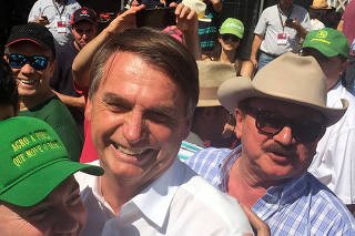 FILE PHOTO: Nabhan Garcia, the head of farmers group, is seen next to Jair Bolsonaro, far-right lawmaker and presidential candidate of the Social Liberal Party (PSL) in Ribeirao Preto