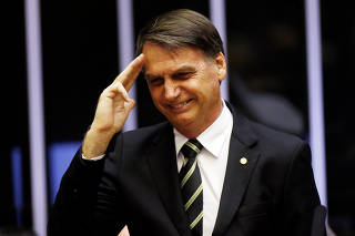 Brazil's President-elect Jair Bolsonaro gestures during a session at the National Congress in Brasilia
