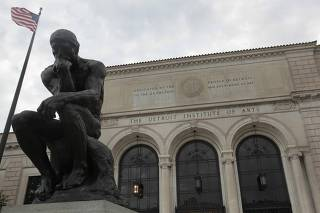 A statue of 'The Thinker' by sculptor Aguste Rodin is seen in front of the Detroit Institute of Arts museum in Detroit
