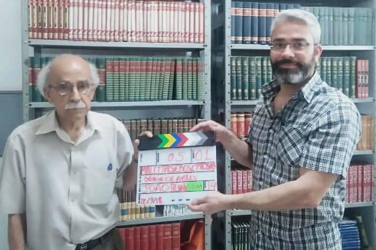 Renato de Assumpção e Silva (1932-2018), livreiro de Belo Horizonte, com o filho, João Alfredo