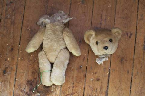 A teddy bear in two pieces is pictured on the workshop floor at Sydney's Doll Hospital, August 19, 2014. Opened in 1913, Sydney's Doll Hospital has worked on millions of dolls, teddy bears and other toys. Behind a toy shop on a busy suburban street in Sydney's south,