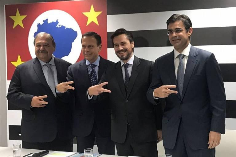 Doria em foto com dois secretários recém-anunciados