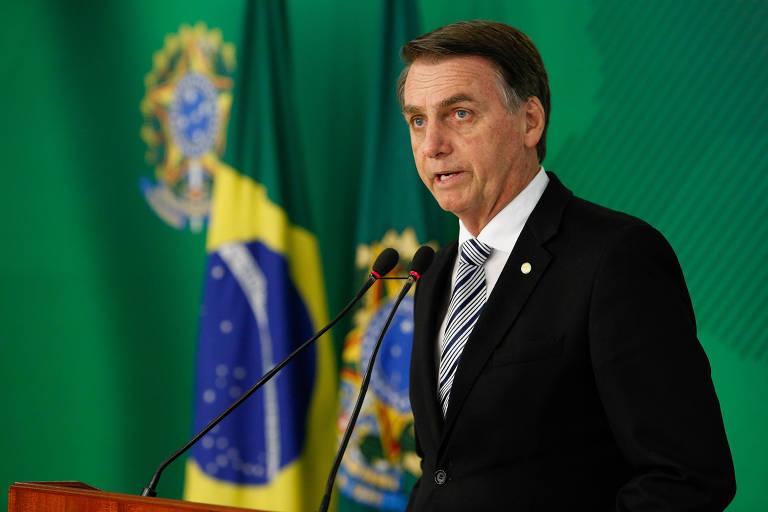 O presidente eleito, Jair Bolsonaro (PSL), durante evento com o atual presidente, Michel Temer