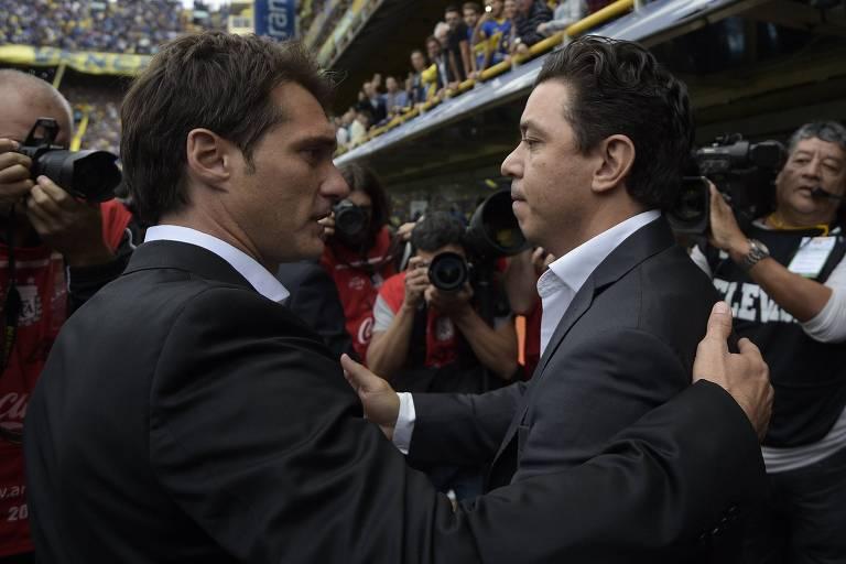 Guillermo Barros Schelotto e Marcelo Gallardo se cumprimentam antes de clássico disputado em 2016