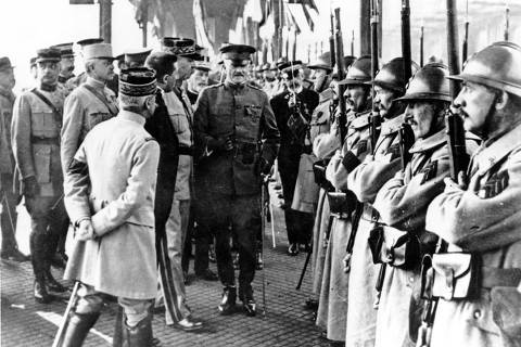 EIGHTY OF ONE HUNDRED PHOTOS WORLD WAR ONE CENTENARY TIMELINE - In this June 13, 1917 file photo, U.S. Army General John J. Pershing, center, inspects French troops at Boulogne, France. (AP Photo, File) ORG XMIT: BRU180