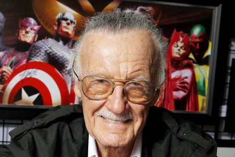 FILE - This Oct. 12, 2012 file image released by Starpix shows Marvel Comics scribe and film producer Stan Lee at a special signing, hosted by Choice Collectibles, a publisher of Marvel fine art, during New York Comic Con at Jacob K. Javits Convention Center in New York. Lee is missing in action at Comic-Con International, held July 24-27, 2014, in San Diego. A spokesman for the 91-year-old co-creator of such comic book superheros as The Avengers, X-Men and Spider-Man says Lee lost his voice because of laryngitis and is unable to attend the four-day pop-culture celebration.  (AP Photo/Starpix, Marion Curtis, file) ORG XMIT: CAET434