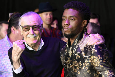 FILE - In this Monday, Jan. 29, 2018 file photo, comic book legend Stan Lee, left, creator of the