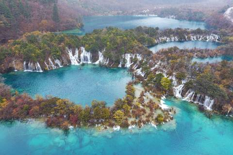 (181108) -- JIUZHAIGOU, Nov. 8, 2018 (Xinhua) - An aerial photo taken on Nov. 6, 2018 shows the scenery in the Jiuzhaigou National Park in southwest China's Sichuan Province. The park, a UNESCO World Heritage Site, was rocked by a 7.0-magnitude quake in August 2017. (Xinhua/Liu Kun) (clq)