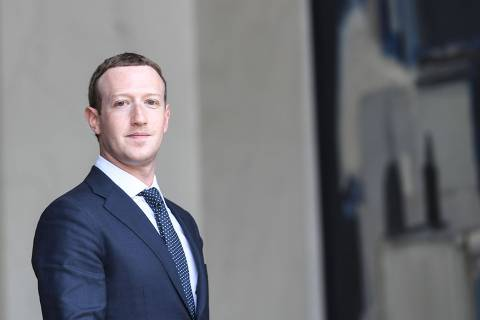 (FILES) In this file photo taken on May 23, 2018 Facebook's CEO Mark Zuckerberg leaves the Elysee presidential palace, in Paris,  following a meeting with French President on the day of the