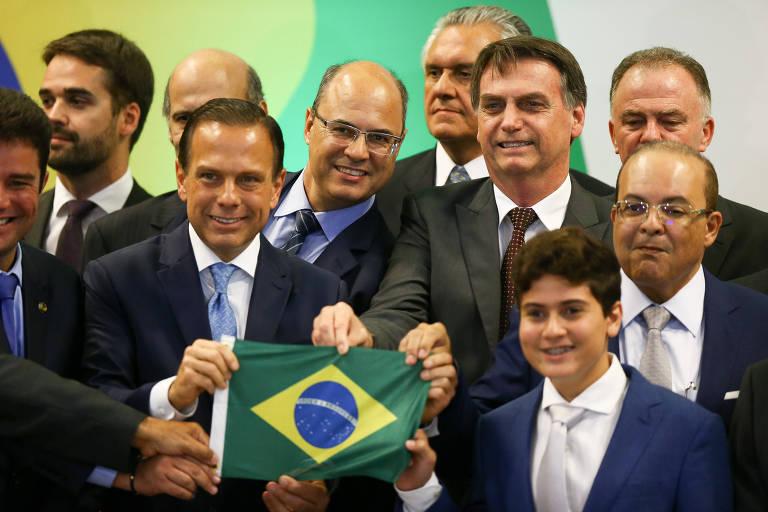 O presidente Jair Bolsonaro participa de reunião do Fórum de Governadores, no CICB (Centro Internacional de Convenções do Brasil). Ao lado dele, na mesa, o governador eleito de SP João Dória (PSDB) o governador eleito do DF Ibaneis Rocha (MDB) e o governador eleito do RJ Wilson Wytzel.
