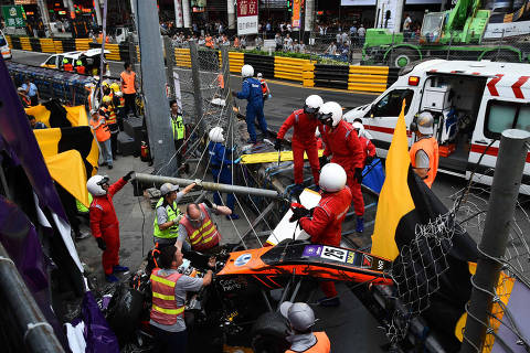 Race personnel and pit crew are seen at the accident site after Sophia Floersch, a German driver of Van Amersfoort Racing flew over the barriers and crashed into a photographers' bunker at high speed, during a Formula Three race at the Macau Grand Prix, in Macau, China November 18, 2018. Mai Shangmin/CNS via REUTERS ATTENTION EDITORS - THIS IMAGE WAS PROVIDED BY A THIRD PARTY. CHINA OUT. ORG XMIT: PEK03