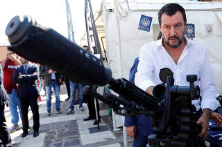 FILE PHOTO: Italian Deputy Prime Minister and Interior Minister Matteo Salvini stands next to a sniper rifle during an event involving the state police SWAT team in Rome