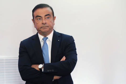 FILE - In this Oct. 6, 2017, file photo, Renault and Nissan Motor Co.'s chairman Carlos Ghosn listens during a media conference outside Paris, France. Nissan Motor Co. says an internal investigation found that its chairman, Carlos Ghosn, has underreported his income. The auto company said he will be dismissed. (AP Photo/Michel Euler, File) ORG XMIT: BKWS327