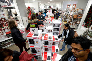 Customers shop for small appliances during the Black Friday sales event on Thanksgiving Day at JCPenney in Niles