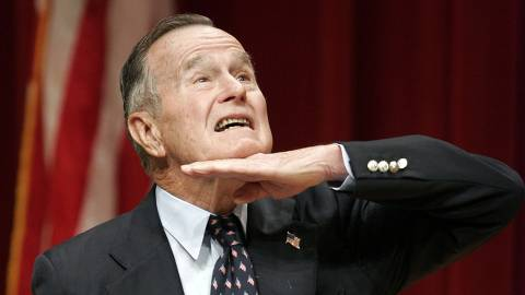 ORG XMIT: 555301_0.tif Former U.S. President George H.W. Bush jokes during a speech at a naturalization ceremony 11 March 2005 at the George Bush Presidential Library in College Station, Texas. A group of 47 active duty soldiers became U.S. citizens during the ceremony. (Karl Stolleis/Getty Images/AFP) FOR NEWSPAPERS AND TV USE ONLY