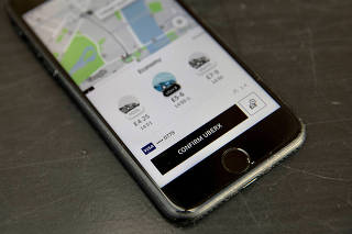 FILE PHOTO: A photo illustration shows the Uber app on a mobile telephone in London