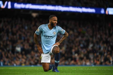 Manchester City's English midfielder Raheem Sterling reacts after missing a chance during the English Premier League football match between Manchester City and Bournemouth at the Etihad Stadium in Manchester, north west England, on December 1, 2018. (Photo by Paul ELLIS / AFP) / RESTRICTED TO EDITORIAL USE. No use with unauthorized audio, video, data, fixture lists, club/league logos or 'live' services. Online in-match use limited to 120 images. An additional 40 images may be used in extra time. No video emulation. Social media in-match use limited to 120 images. An additional 40 images may be used in extra time. No use in betting publications, games or single club/league/player publications. /
