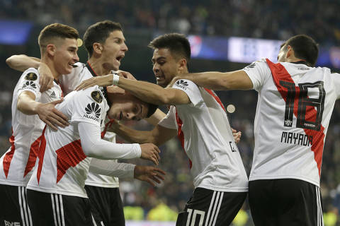 Juan Quintero of Argentina's River Plate celebrates with his teammates after scoring River's second goal in overtime against Argentina's Boca Juniors during the Copa Libertadores final soccer match at the Santiago Bernabeu stadium in Madrid, Spain, Sunday, Dec. 9, 2018. (AP Photo/Thanassis Stavrakis) ORG XMIT: XTS145