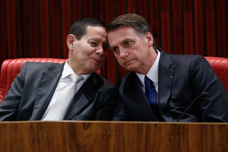 O presidente eleito, Jair Bolsonaro (PSL), e seu vice, Hamilton Mourão (PRTB), na cerimônia de diplomação que atestou a vitória nas urnas e o mandato de quatro anos para a chapa. Os documentos foram entregues pela presidente do TSE, ministra Rosa Weber