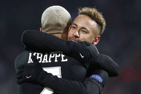 PSG Kylian Mbappe celebrates with teammate Neymar his side's fourth goal during the Champions League group C soccer match between Red Star and Paris Saint Germain, in Belgrade, Serbia, Tuesday, Dec. 11, 2018. (AP Photo/Marko Drobnjakovic) ORG XMIT: XSG125