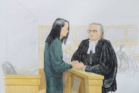 TOPSHOT - In this courtroom sketch by Jane Wolsak and released to AFP by the artist, Meng Wanzhou (L), Huawei's chief financial officer, speaks with lawyer David Martin in the courtroom in Vancouver, British Columbia on December 10, 2018. - Meng Wanzhou, Huawei's chief financial officer, faces US fraud charges related to alleged sanctions-breaking dealings with Iran, and has been awaiting a Canadian court's bail decision. (Photo by Jane Wolsak / Jane Wolsak / AFP)