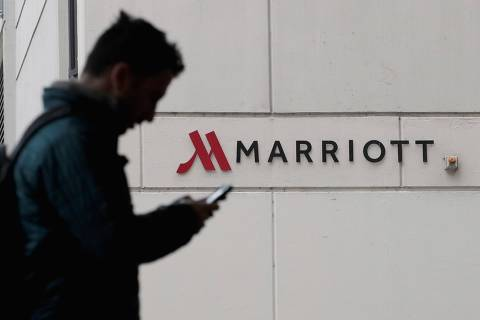 CHICAGO, IL - NOVEMBER 30: A sign marks the location of a Marriott hotel on November 30, 2018 in Chicago, Illinois. Marriott says their Starwood guest reservation database was hacked, compromising the security of private information for up to 500 million hotel customers.   Scott Olson/Getty Images/AFP