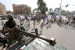 Houthi militant mans a machine gun mounted on a patrol a vehicle in Hodeidah