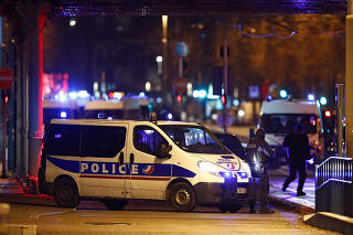 French special police forces secure an area during a police operation in the Meinau district after the deadly shooting in Strasbourg