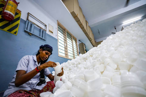 A worker at a plastic factory in Chennai, India, sorts disposable cups used in take-out meals. The factory's parent company produces two billion pieces of packaging and single-use plastic for multinational brands and local clients