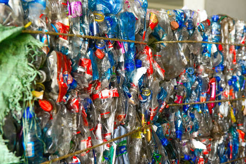 At a recycling center in Johannesburg, South Africa, bales of PET bottles are bound in gold-colored rope made from recycled plastic