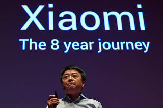 Senior vice president of Xiaomi, Xiang Wang, speaks at a UK launch event in London