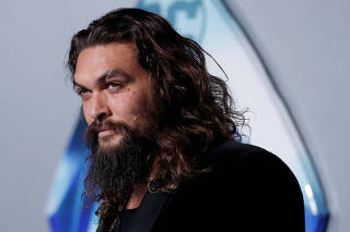 Cast member Momoa poses at the premiere for