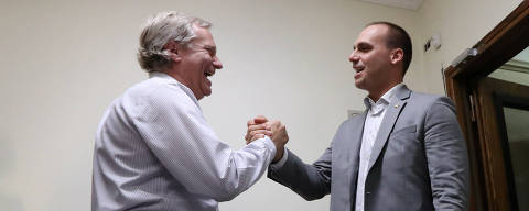 Eduardo Bolsonaro, son of Brazil's President-elect Jair Bolsonaro, and Chilean far-right politician Jose Antonio Kast meet in Santiago, Chile December 13, 2018. REUTERS/Ivan Alvarado ORG XMIT: GGGIA203