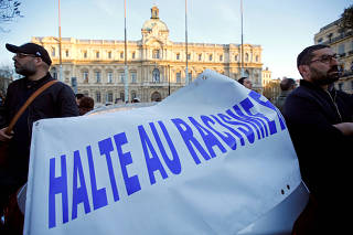 FILE PHOTO: People attend a gathering in Marseille, France in memory of Mireille Knoll, an 85-year-old Holocaust survivor stabbed to death and burnt in her Paris apartment