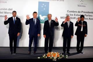 Paraguay's President Mario Abdo Benitez, Argentina's President Mauricio Macri, Uruguay's President Tabare Vazquez, Brazil's President Michel Temer and Bolivia's President Evo Morales pose during a Mercosur trade block summit in Montevideo