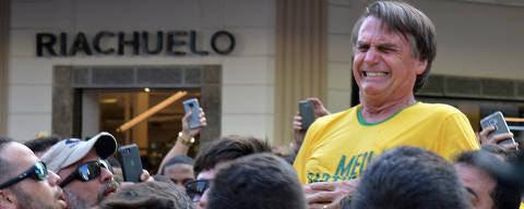 Brazilian presidential candidate Jair Bolsonaro reacts after being stabbed during a rally in Juiz de Fora, Minas Gerais state, Brazil, September 6, 2018. REUTERS/Raysa Campos Leite        SEARCH