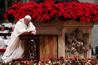 Pope Francis leads the Christmas Eve mass in Saint Peter's Basilica at the Vatican